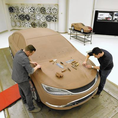 Finishing a car model at the GM factory