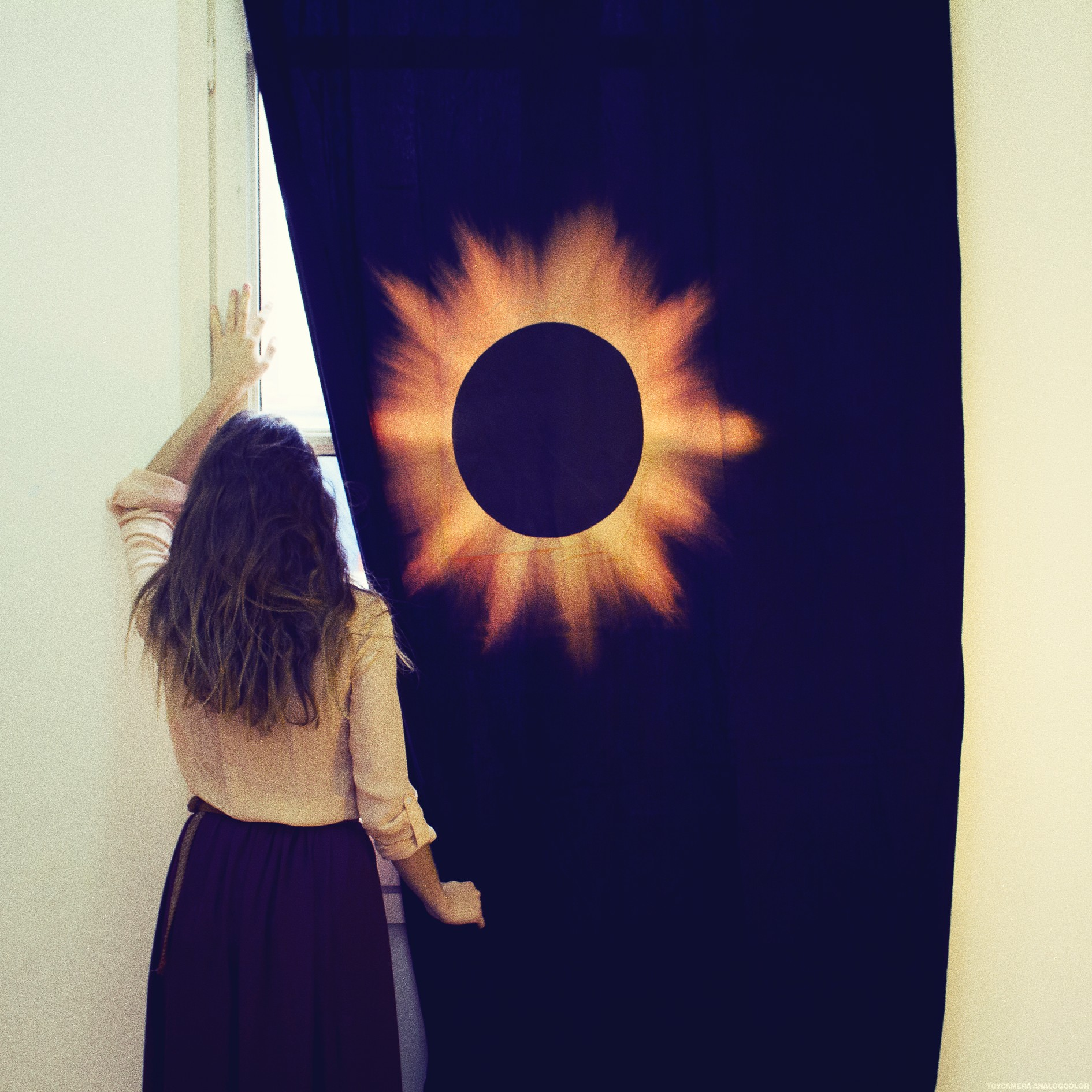 Black Eclipse on Black Curtains