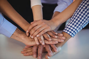 Solidarity: 6 hands stacked on top of each other