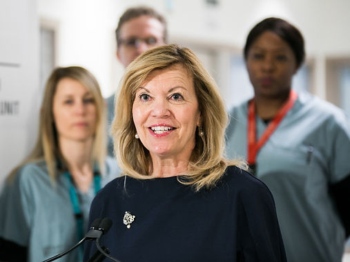 Minister of Health Christine Elliott in foreground, with three health care workers in background taken at Ontario Shores press conference