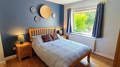 En-suite bedroom with garden view