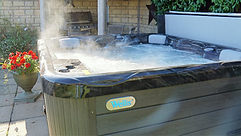 Steaming hot tub and barbeque