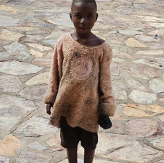 David is a motherless child living under poor condtions, now benefiting from our program.