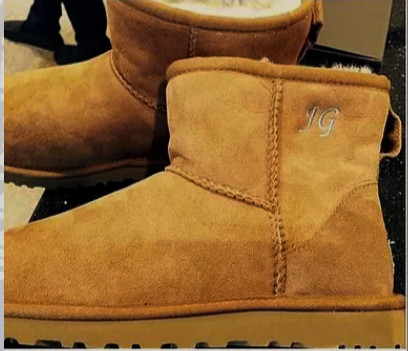 Embroidering intials onto Ugg boots.