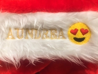 Festive embroidered intials and emojis onto Santa hats.