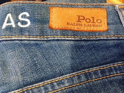 Embroidered initials onto denim jeans for Ralph Lauren