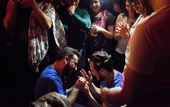 Nader, left, puts a ring on Omar's finger after proposing during Omar's birthday party in Istanbul. Courtesy Bradley Secker