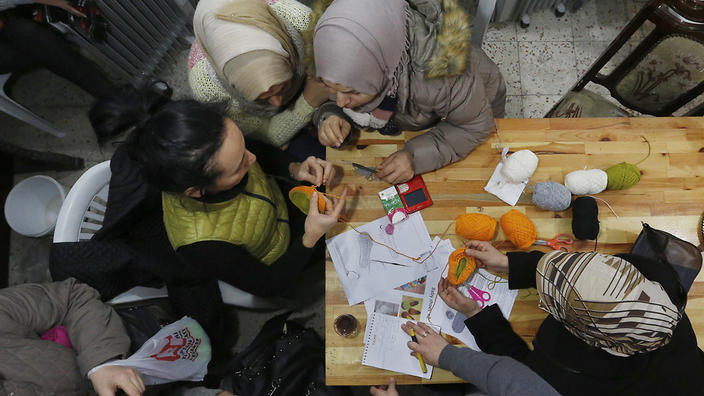 Syrian refugees attend a knitting lesson in Istanbul