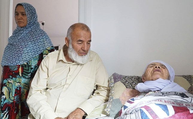 106-year-old Afghan refugee Bibihal Uzbeki rests in bed attended by her son Mohammadollah and daughter-in-law Ziba, in Hova, Sweden, Sept. 3, 2017. Despite being severely disabled and barely able to speak, Uzbeki is facing deportation.