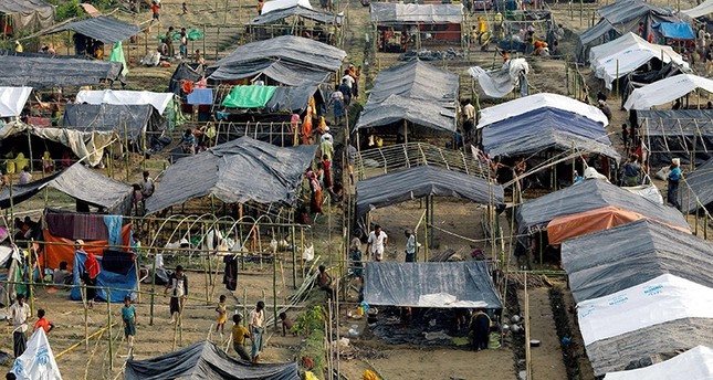 This file photo taken on Sept. 5, 2017 shows Rohingya refugees from Myanmar's Rakhine state set up shelters at a refugee camp at Unchiprang near the Bangladeshi border town of Teknaf