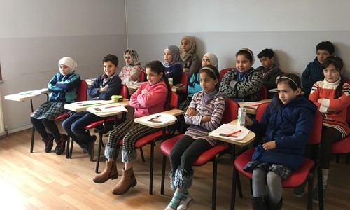 Syrian children, who had fled their country and took shelter in Turkey, enjoy Turkish lessons at the Turkish Red Crescent Community Center