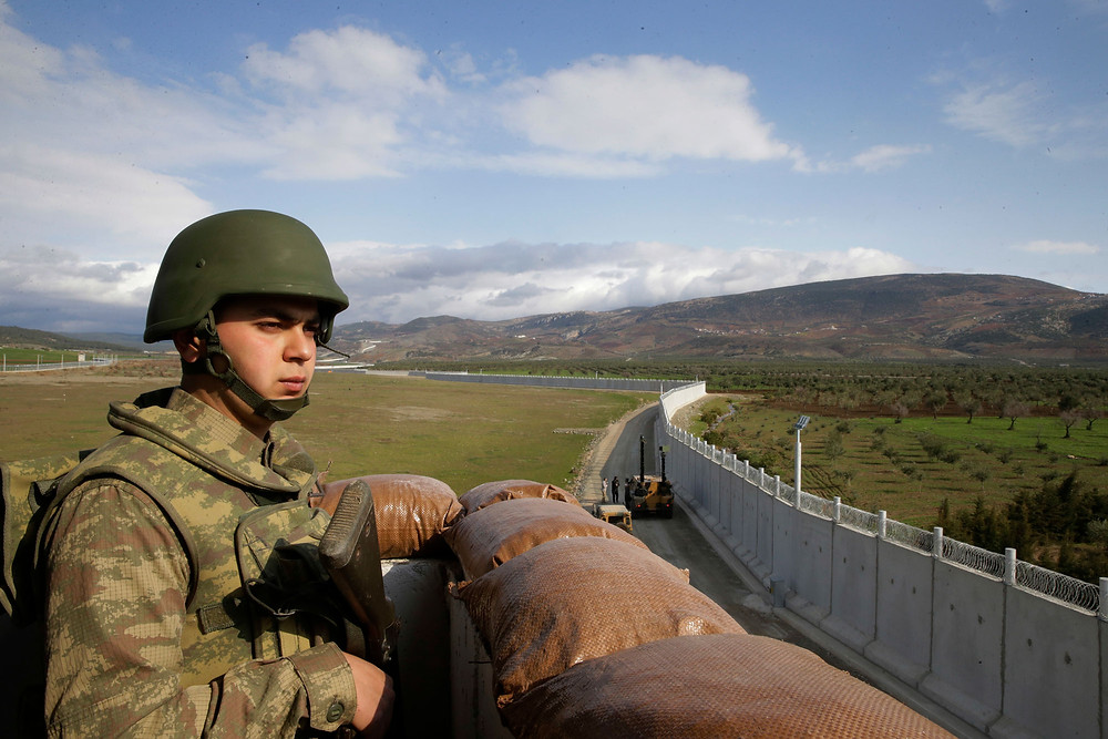A Turkish soldier at an outpost near the town of Kilis, southeastern Turkey, adjacent to the wall Turkey has constructed along its border with Syria