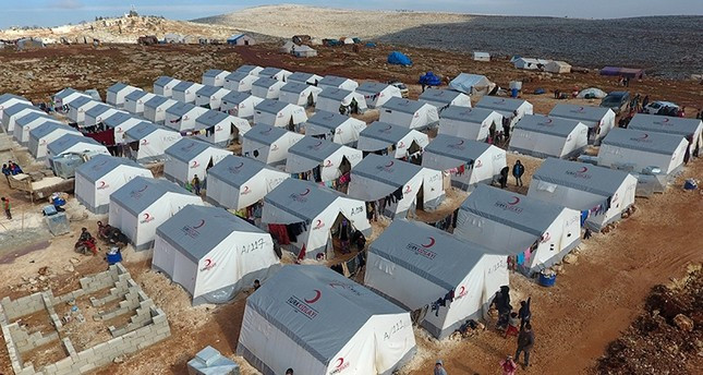 This aerial photo dated Aug. 18, 2017, shows the Kemmune refugee camp established by the Turkish Red Crescent north of Idlib, Syria