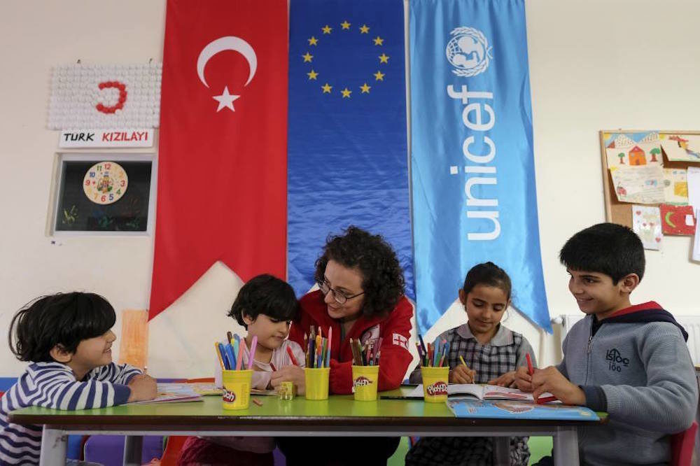 The Reshid children - Melek, Zeynep, Silva and Ahmed - do their school homework