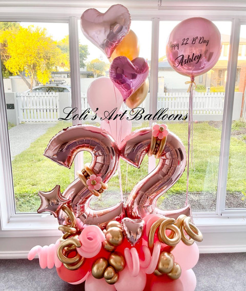 Grand balloon bouquet with foil hearts and personalized balloon Price: $205