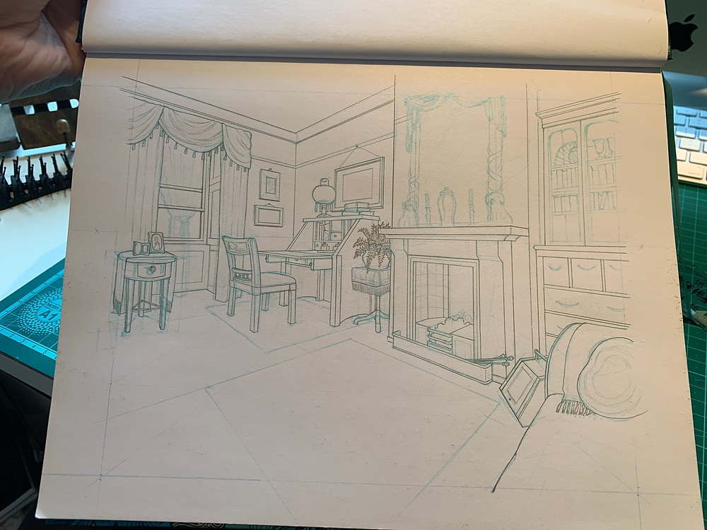 A photo of a sketchbook with a living room drawn on it.