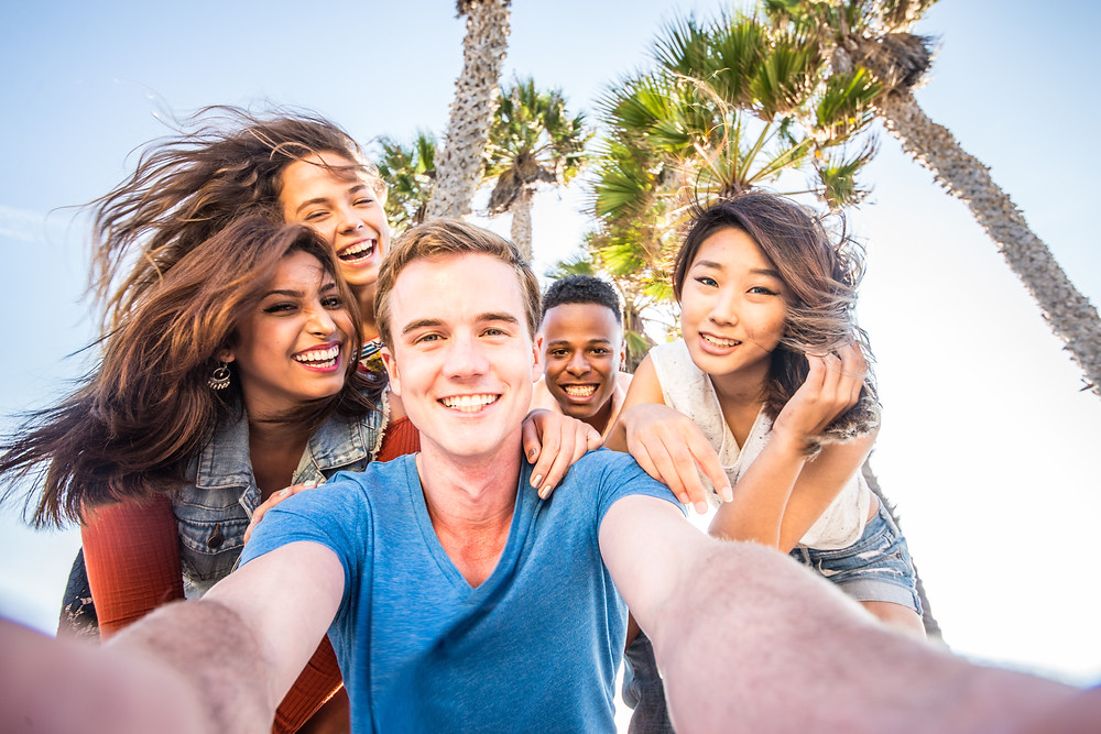 Group of teens taking selfie smiling. Represents the need for emdr for depression katy, tx and depression therapist katy, tx 77494.