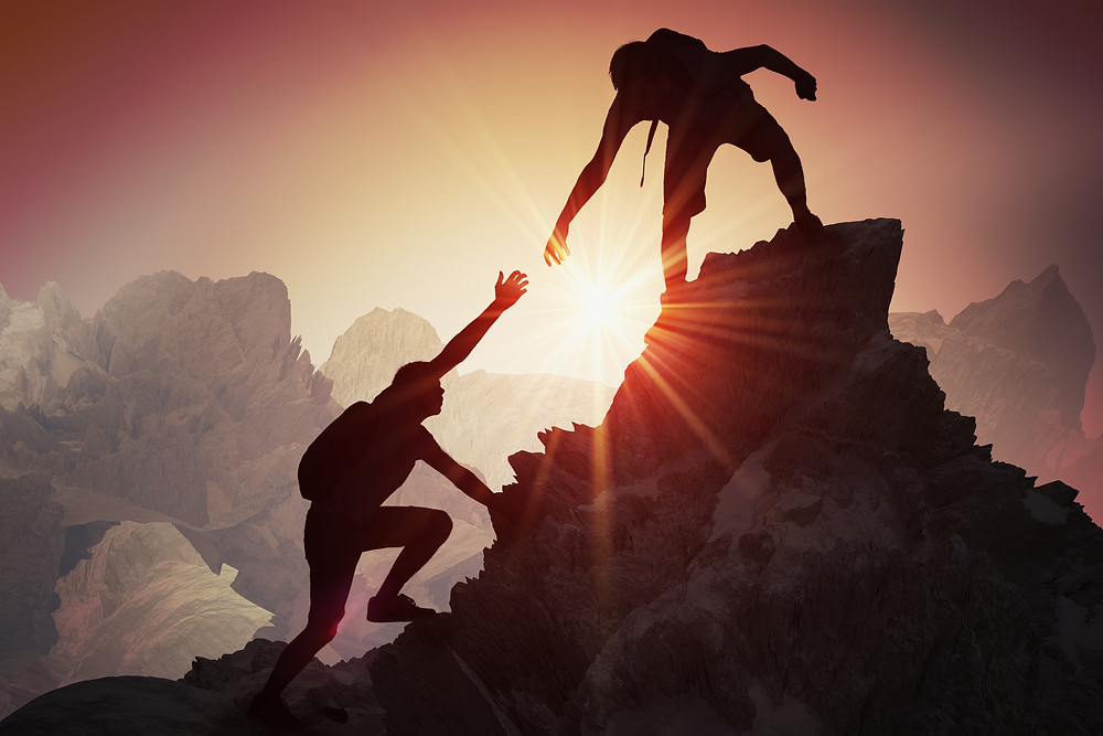 Helping a climber to the top of the mountain. Represents help a therapist for teen depression can provide in katy texas 77494. Also represents neurofeedback counseling in katy texas or houston texas.