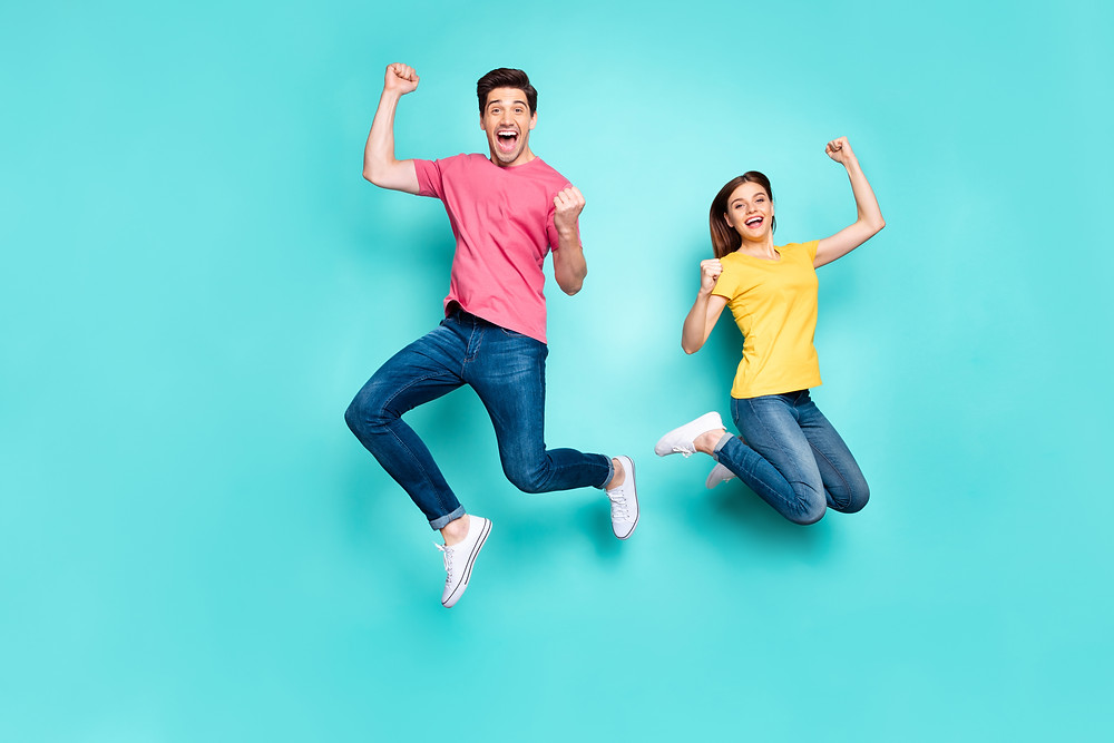 Man and woman jumping in the air smiling. Represents the need for couples counseling katy, tx and marriage therapy katy, tx 77494.