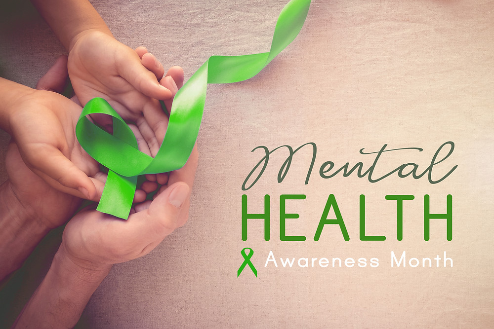 Hands holding a green ribbon mental health awareness month. Represents the need for parent counseling katy, tx and cognitive behavioral therapy for teens katy, tx 77494.