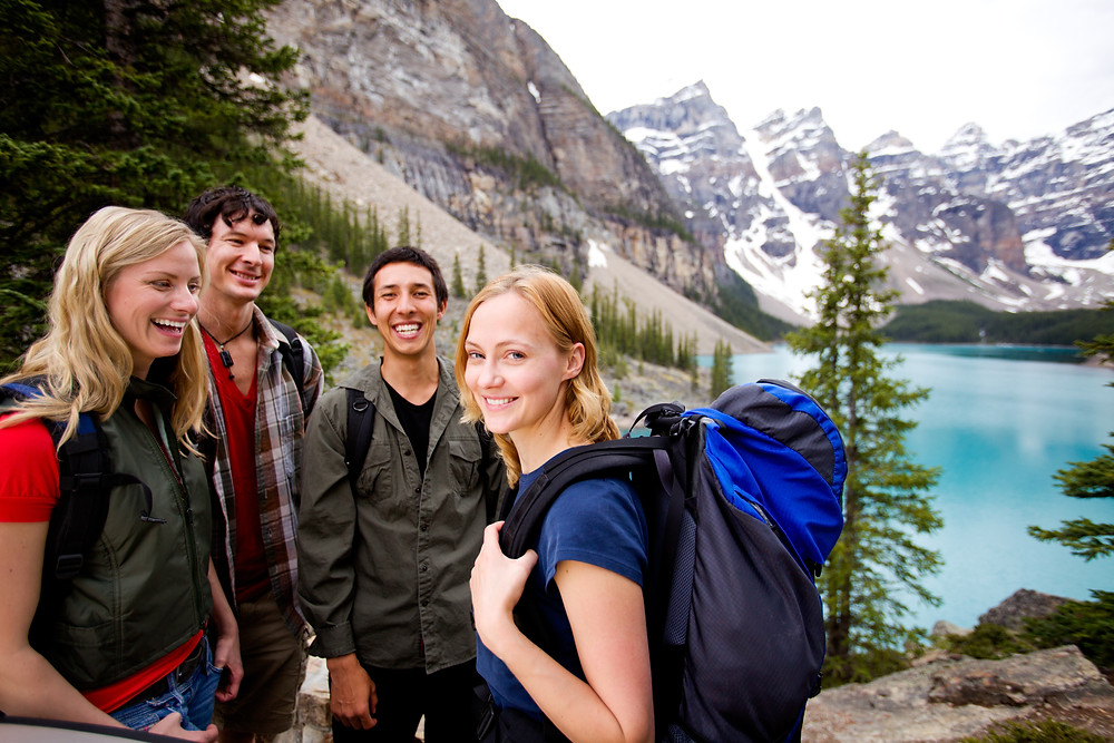 Group of young adults hiking moraine lake. Represents the need for counselors for young adults katy, tx 77494. Also represents the need for counseling for young adults katy, tx 77494.