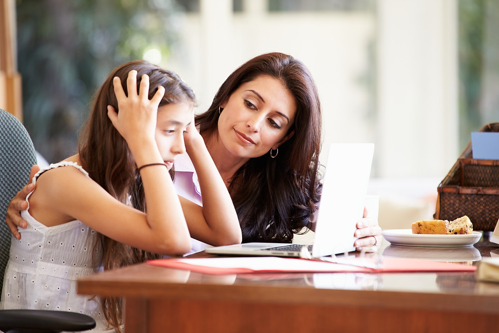 Mother comforting daughter. Represents the need for social anxiety therapy katy, tx. Also represents the need for neurofeedback for anxiety houston texas.