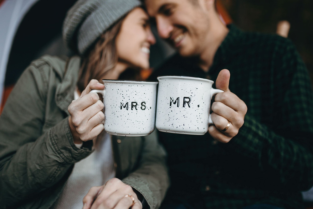 """Man and woman holding coffee mugs with """"mrs."""" and """"mr."""" written on them. Represents the need for marriage counselors katy, tx and couples therapists katy, tx 77494. Also represents the need for marriage counseling and couples therapy katy, tx 77494."""