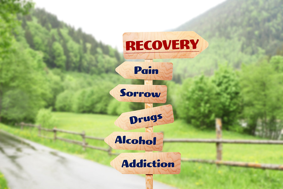 Wooden sign pointing way to recovery. Represents teen counseling for teen substance abuse counseling in katy tx 77494. Also represents family counseling for teen drug abuse counseling in Katy tx and Houston tx.