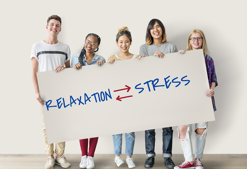 Teenagers holding sign with words relaxation and stress. Represents the need to refresh through EMDR therapy in Katy, tx and family counseling katy, tx. Also represents family therapy in katy, tx 77494