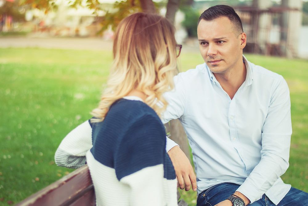 Woman and man sitting on park bench talking. This represents the need for marriage therapist katy, tx and marriage counseling katy, tx. This also represents the need for couples therapy katy, tx and couples therapist katy, tx 77494.
