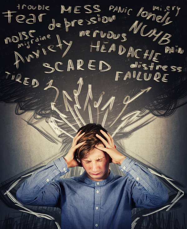 Teen boy holding his head with black cloud with stress words. Represents the need for neurofeedback for anxiety katy texas 77450. Also represents the need for neurofeedback for teen depression in katy texas 77450.