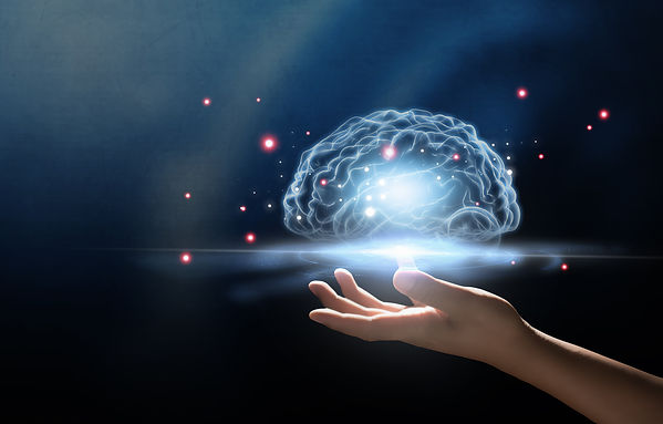 Hand with an electronic representation of a brain hovering over hand. Represents specialists in teen therapy and family counseling in houston texas. Also represents specialist in teen therapy and family counseling in katy texas 77494.