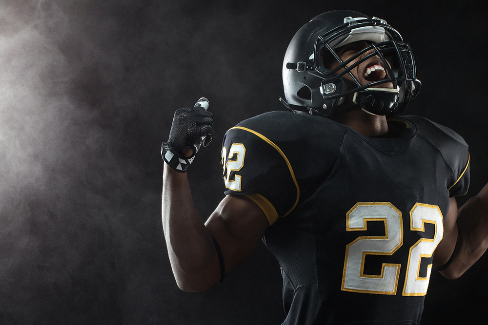 Black football player looking up shouting. Represents the need for emdr for teens katy tx and emdr in katy, tx 77450. Also represents the need for emdr counseling in katy tx.