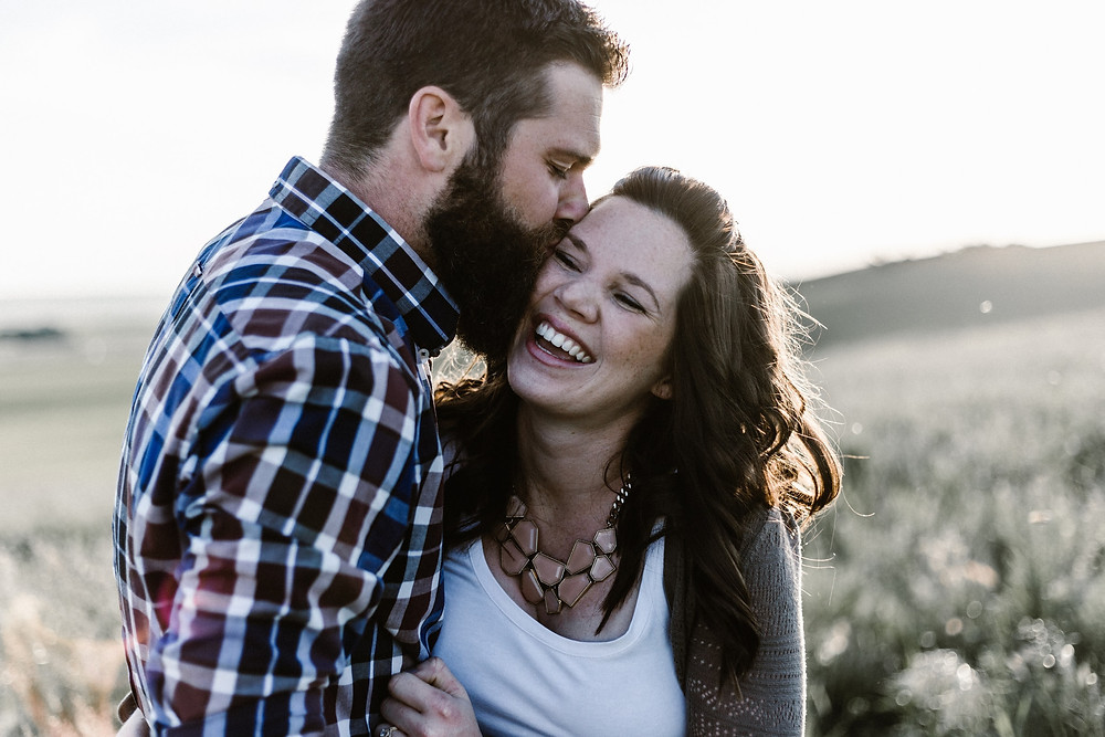 Couple and man with beard kissing woman on cheek. Represents the need for marriage counseling katy, tx and couples therapy katy, tx 77494.