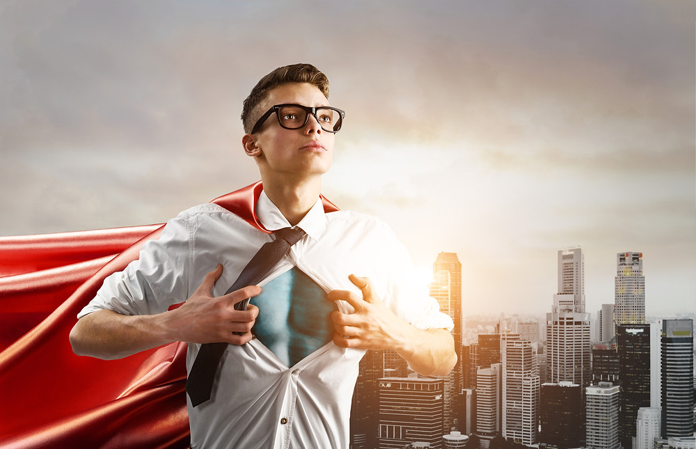 Teen boy in glasses with red cape opening front of shirt like superman. Represents the need for teen counselors in katy, tx and teen therapists katy, tx 77494. Also represents the need for teen depression counseling katy, tx and teen anxiety counseling katy, tx 77494.