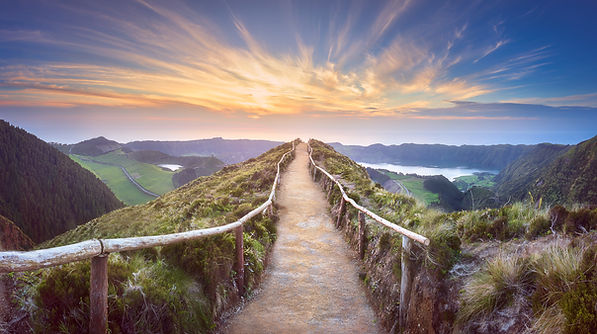 Pathway in mountains leading to sunset. Represents teen ADHD neurofeedback in Katy Texas 77494 and happy teens. Also represents neurofeedback in Houston Texas.