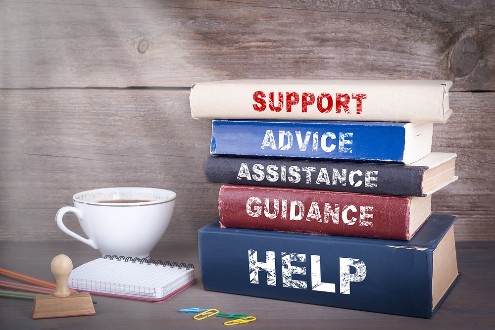 Stack of books on a table with a cup of coffee and notepad. Represents therapy for families in katy tx. Also represents family therapy in Katy tx and family counseling houston, tx.