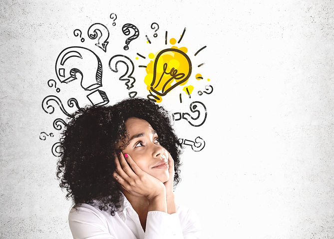 Teen girl thinking with question marks and a light bulb over her head. Represents a teenager needing teen counseling and teen therapy in houston texas and katy texas 77493.