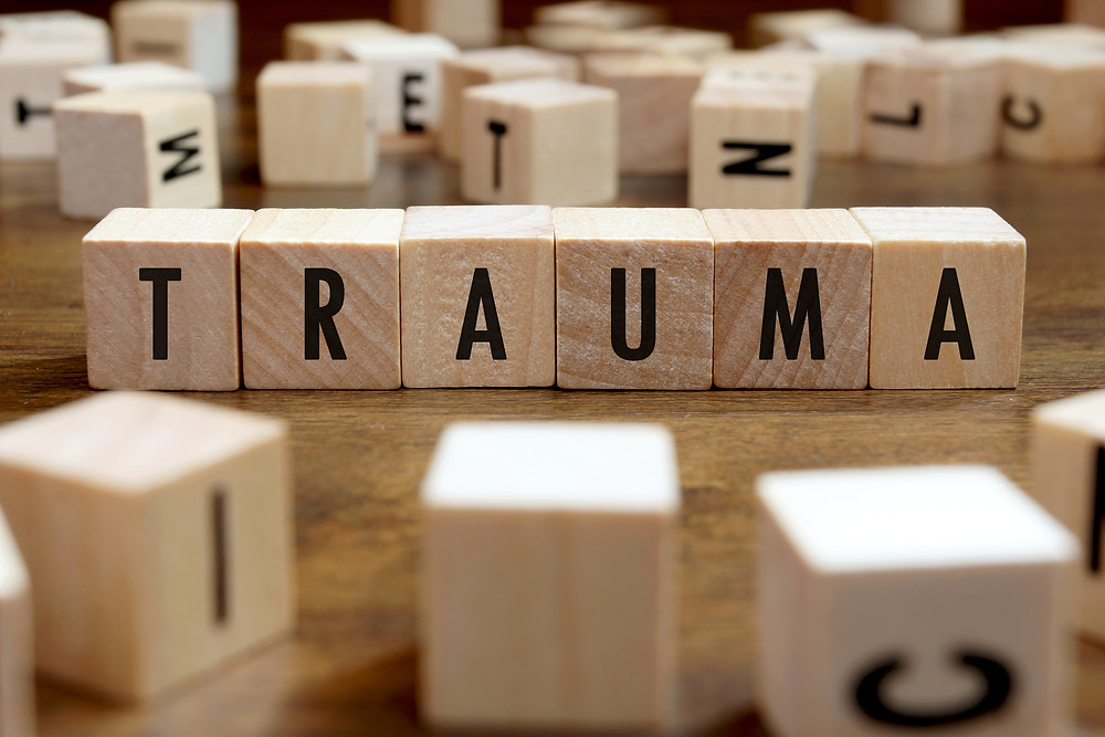 Wood blocks spelling trauma. Trauma counseling for teens katy, texas and houston, texas. Also trauma therapy for teens in katy texas and houston texas.