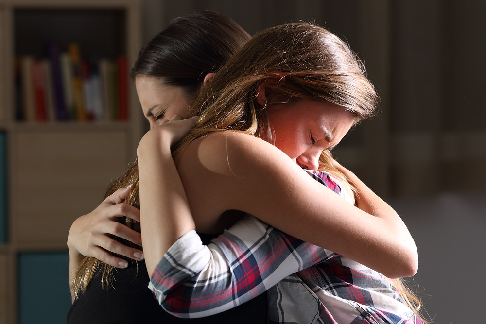 Mother hugging sad daughter.  Represents family counseling katy tx 77494. Also represents family therapy in katy tx and family therapy in houston tx.
