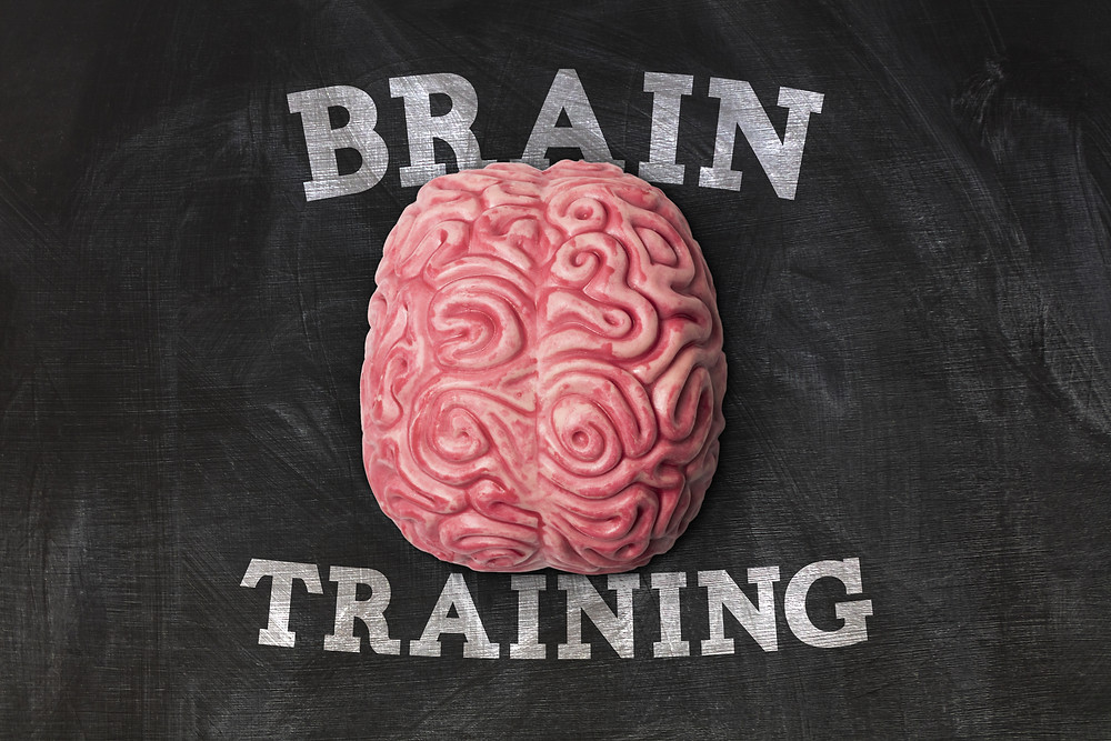 Brain on a chalk board with Brain Training written. Represents neurofeedback for PTSD houston texas. Also represents neurofeedback for ADHD katy texas 77494.