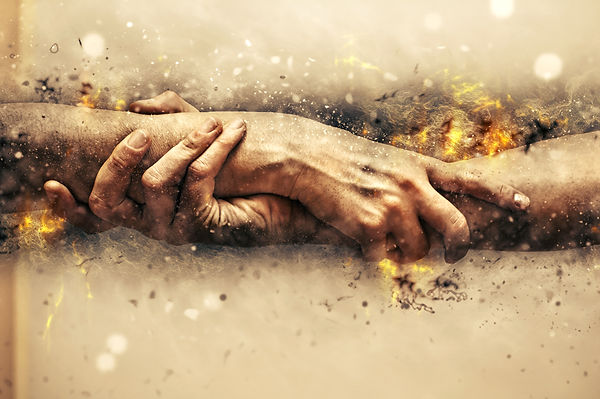 hands grasping each other with flames. Represents support a specialist in trauma therapy for teens in houston texas can give. A specialist in trauma counseling for teens in katy texas is also helpful. 77494.