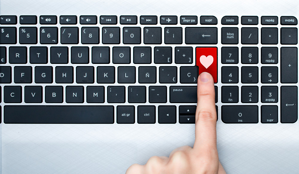 Picture of a computer key board with the enter button red, a heart, and a finger pushing the button. This represents the need for couples counseling katy, tx and couples therapy katy, tx 77494.