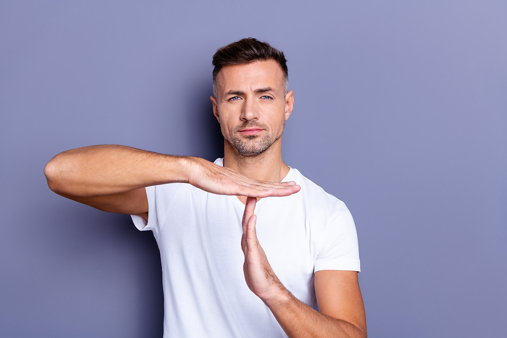 Man giving time out sign with his hands. Represents the need for couples therapist katy, tx 77494. Also represents the need for marriage counselor katy, tx 77494.