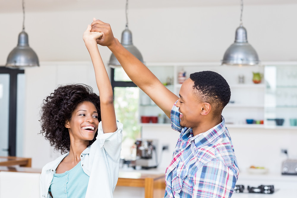 Black couple dancing in kitchen. Represents the need for marriage counseling katy, tx 77494 and couples therapy katy tx, 77494.  Also represents the need for a marriage therapist katy tx, 77494 and couples therapist katy, tx 77494.