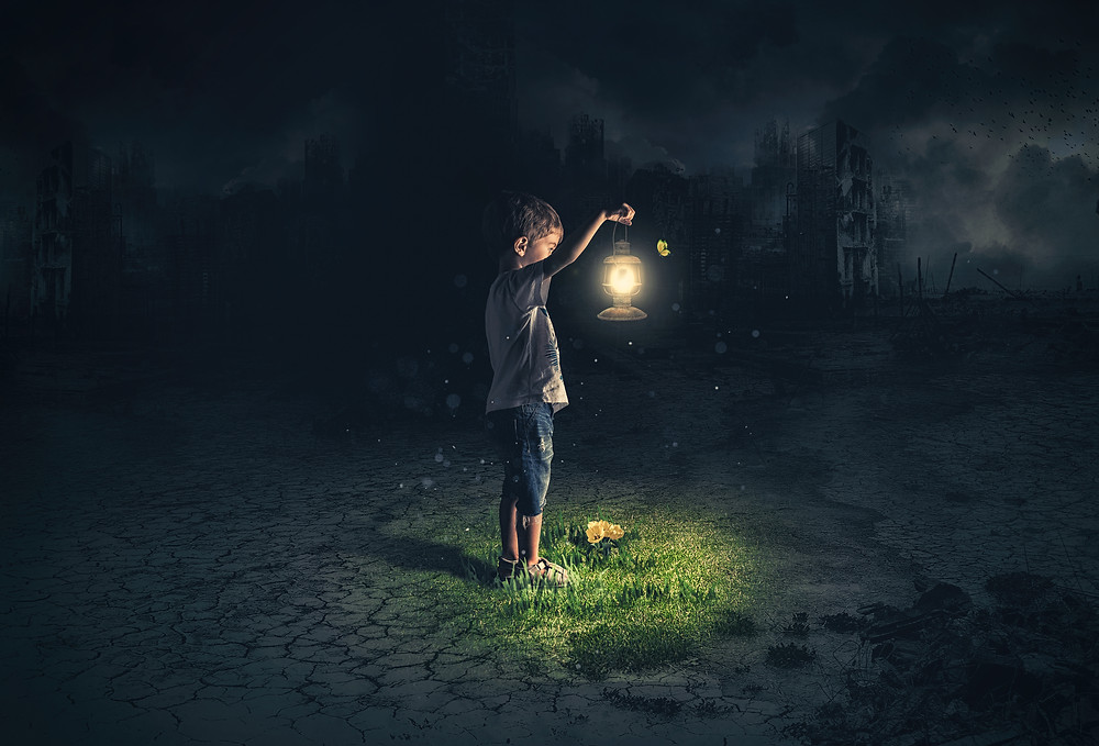 Child holding a lantern in darkness with a destroyed city in background. Represents need for teen counseling houston texas and teen therapy katy texas 77494.