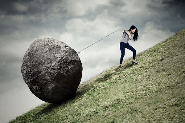 Teenager pulling boulder uphill. Represents the burden of teen depression and need for a therapist for teen depression for teen depression therapy in houston texas and katy texas. 77493.