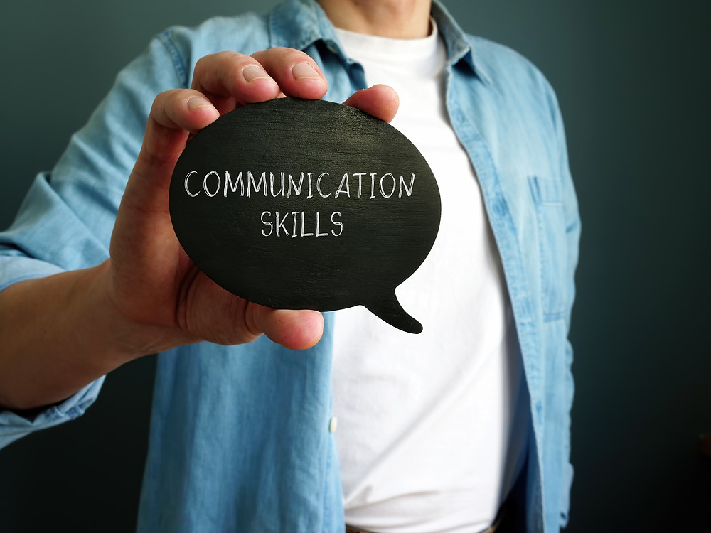 Man holding a quote saying communication skills. Represents the need for marriage counseling katy, tx 77494 and couples therapy katy, tx 77494.