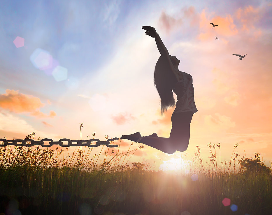 teen girl jumping breaking her chains. Represents PTSD counseling for teens katy texas. Could also represent PTSD counseling for teens houston texas. Trauma therapy 77493.