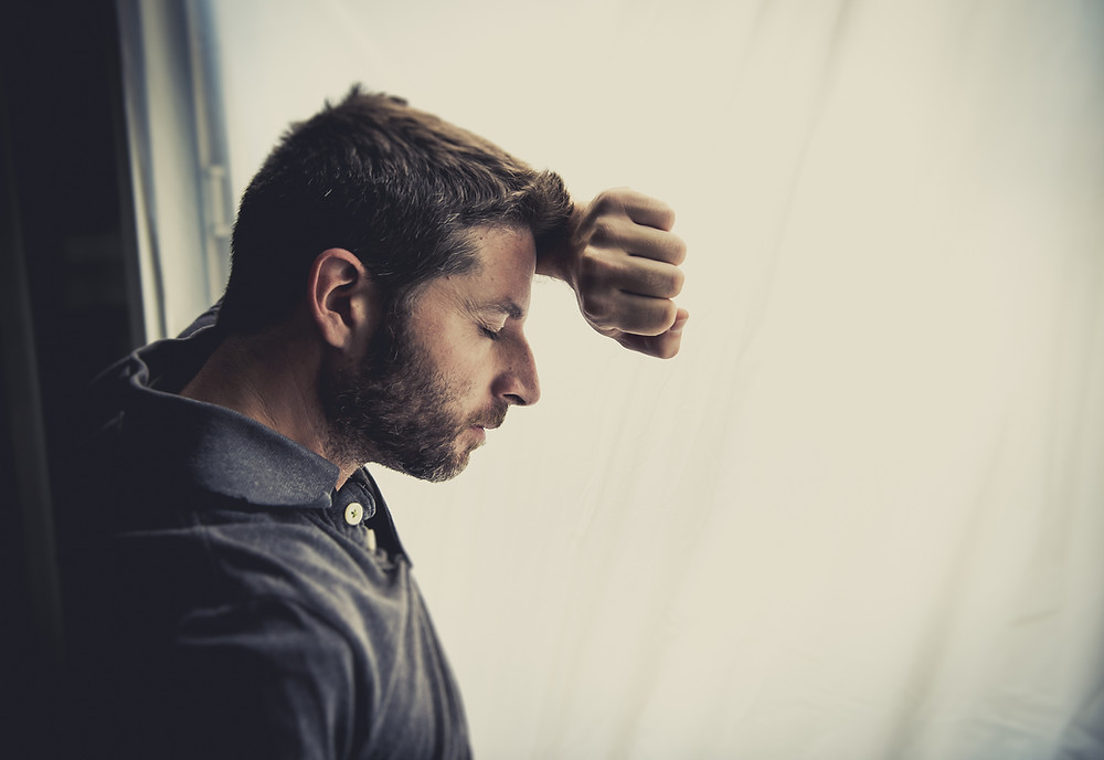 Man leaning his head against his arm on a window closing his eyes. This represents the need for couples counseling katy, tx and for couples therapy katy, tx. Also the need for marriage counselors and couples therapists or marriage therapists or couples counselors katy, tx 77494.